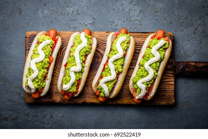 Chilean Completo Italiano. Hot dog sandwich with tomato, avocado and mayonnaise. Top view, copy space