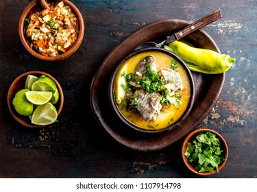 CHILEAN FOOD. Fish soup CALDILLO DE CONGRIO served in clay bowl, top view.