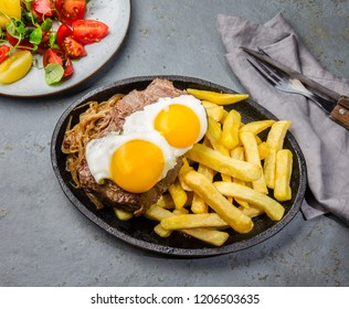 Chilean food. Lomo a lo pobre. Beef whit fried potatoes french fry and eggs