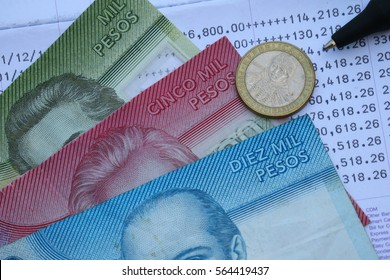 Chilean Peso cash banknote and coin on bank statement, saving finance and investment concept