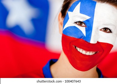 Chilean woman with the flag painted on her face