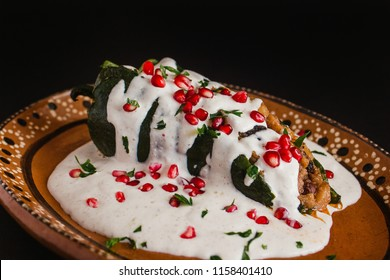 Chiles en Nogada, traditional Mexican cuisine in Puebla Mexico black background