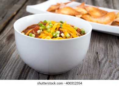 chili con carne bowl over a wooden table