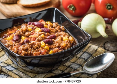 Chili con carne in a bowl. Traditional dish of mexican cuisine.