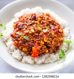 Chili con carne is made from beef, tomato puree, corn, red bean, pepper, onion, garlic served on rice