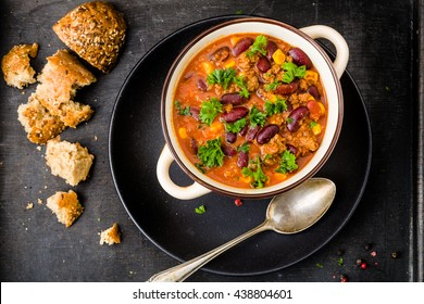 Chili con carne on a wooden background