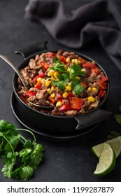 chili con carne, traditional mexican dish, top view, dark background