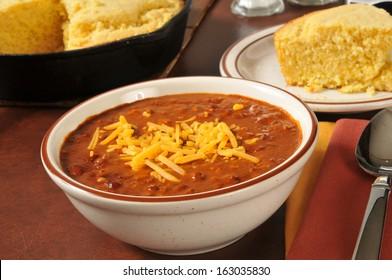 Chili and cornbread in a cast iron skillet
