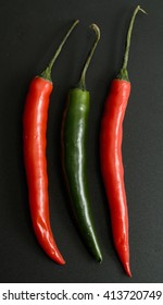 chili pepper on a black background