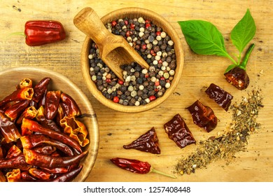 Chili pepper on wooden background.Extra hot chili pepper Naga Bhut Jolokia Chocolate. Healthy spice. Sale Chili.