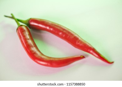 Chili Pepper in pale green light. Shallow depth of field. Hot pepper has the specific taste due to a special ingredient called capsaicin. The amount of capsaicin determines how fast the pepper is.
