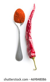 Chili pepper and powdered pepper isolated on white background.