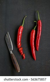 Chili peppers on a black background - lot of blank space
