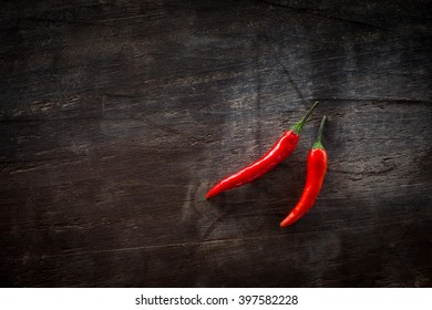 Chili peppers on a dark wooden table