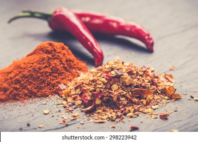 Chili peppers on rustic background( fresh, chopped and dried)