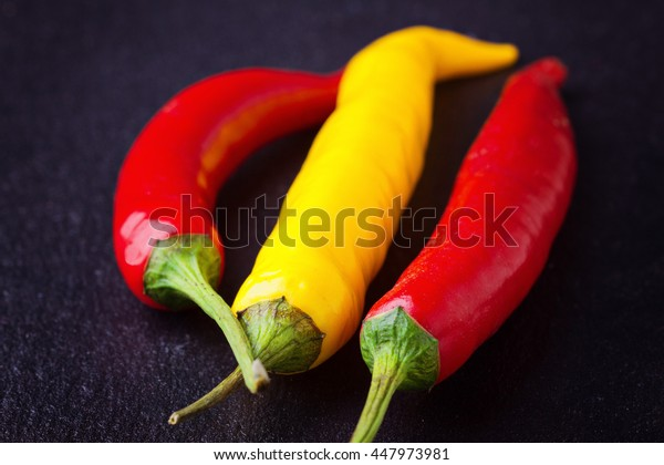 Chili peppers red and yellow selective focus