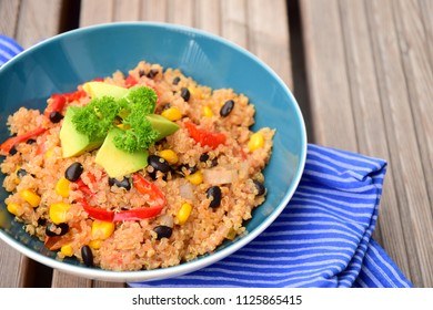 Chili quinoa bowl with black bean, corn, bell pepper, avocado and parsley