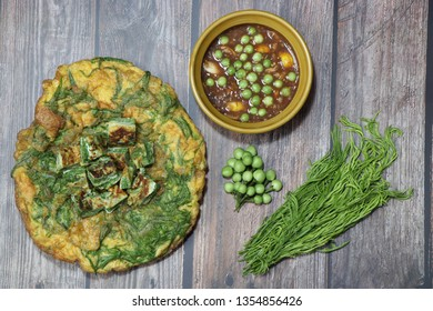 Chili shrimp paste and Omelet with Cha-om ,turkey berry ,Thai food