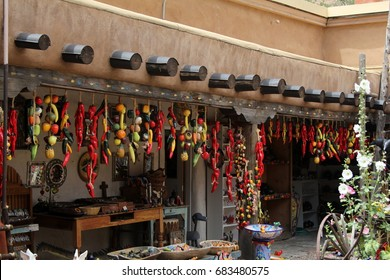 chilies hanging in outdoor market