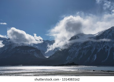 Chilkat Inlet near Haines Alaska with clouds over the mountains.
