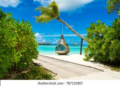 Chill lounge zone on the sandy beach, Maldives island