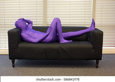 chill out , anonymous man lying and relaxing on the couch