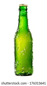Chilled isolated green beer bottle with drops and ice