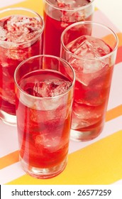 Chilled red beverage with ices on the tall glass