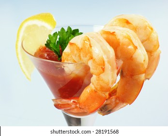 Chilled shrimp served with cocktail sauce in a martini glass.