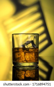 Chilled Whiskey Glass with fizzy soda and Ice Cubes