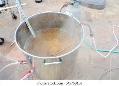Chiller inserted in hot home brew beer kettle to sanitize