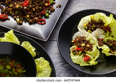 chilli beef lettuce wraps on black plate