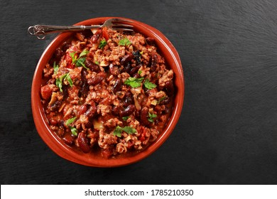 Chilli Con Carne with Minced Beef Vegetables and topped with Coriander on Slate Platter with room for Copy Space