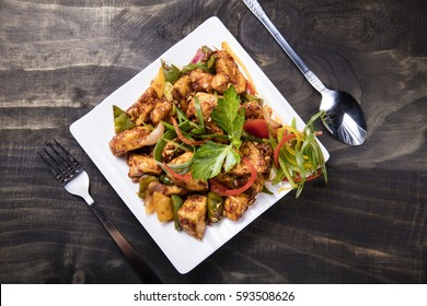 Chilli Paneer placed on a white plate