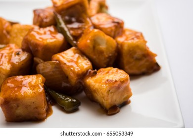 Chilli paneer or Spicy cottage cheese, served with capsicum and onion, favourite indian starter menu, selective focus