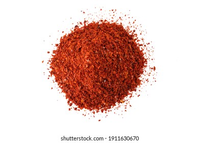chilli pepper seedless flakes heap isolated on white background. Spices and food ingredients. in Korea known as Gochugaru. Used for Kimchi.