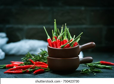 chilli peppers on the black table, chilli background
