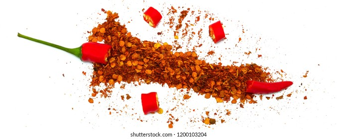 Chilli, red pepper flakes and chilli powder burst on white background.