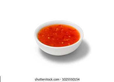 Chilli sauce in a gravy boat on white background