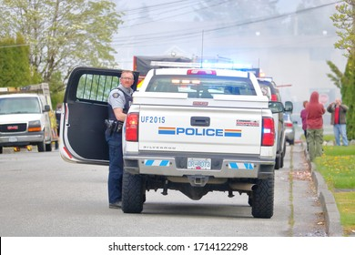 CHILLIWACK, BC - April 25, 2020: An RCMP officer responds to a suspicious fire at 46280 Second Ave. in Chilliwack, BC, Canada on April 25, 2020 that was reported to be inhabited by squatters.