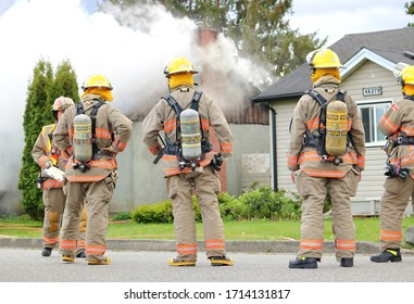 CHILLIWACK, BC - April 25, 2020: Smoke billows from a home at 46280 Second Ave., in Chilliwack, BC, Canada. Gale force winds quickly consumed the home believed to be occupied by squatters at the time.