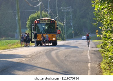 CHILLIWACK, BC/Canada - June 20, 2018: Children in the rural area of Chilliwack, British Columbia, Canada board the morning school bus on June 20, 2018.