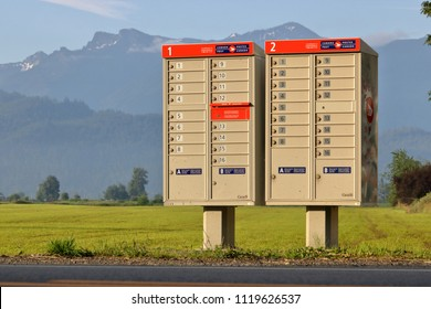CHILLIWACK, BC/Canada - June 24, 2018: A Canada Post multi mailbox is seen in the rural countryside near Chilliwack, British Columbia on June 24, 2018.