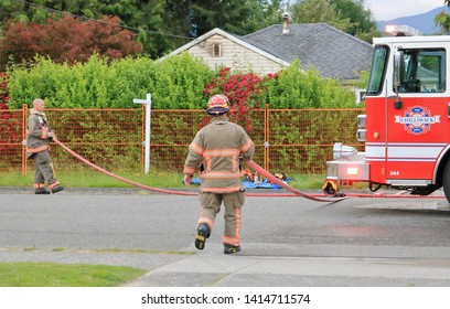 CHILLIWACK, BC/Canada - June 3, 2019: Crew quickly respond to an early morning fire at 46364 Maple ave. in Chilliwack, Canada on June 3, 2019. The vacant home was scheduled for demolition.
