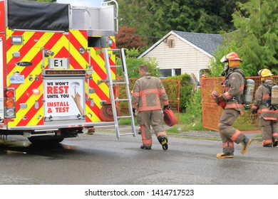 CHILLIWACK, BC/Canada - June 3, 2019: Crew members quickly respond to an early morning fire at 46364 Maple ave. in Chilliwack, Canada on June 3, 2019. The vacant home was scheduled for demolition.