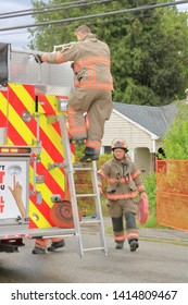 CHILLIWACK, BC/Canada - June 3, 2019: Fire fighters quickly responds to an early morning fire at 46364 Maple ave. in Chilliwack, Canada on June 3, 2019. The home was gated and vacant at the time.