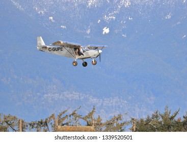 CHILLIWACK, BC/Canada - March 14, 2019: A small, privately owned Zenair STOL CH 701 aircraft descends toward an airport in Chilliwack, BC, Canada on March 14, 2019.