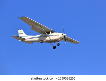 CHILLIWACK, BC/Canada - March 14, 2019: A small CESSNA-172 owned by Skyquest Aviation descends toward the Chilliwack, BC, Canada airport on March 14, 2019.