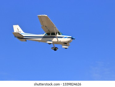 CHILLIWACK, BC/Canada - March 14, 2019: A privately owned Cessna 172N Skyhawk single engine plane descends toward the airport in Chilliwack, BC, Canada on March 14, 2019.