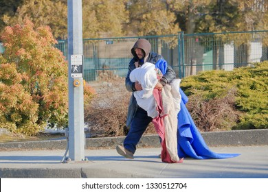 CHILLIWACK, BC/Canada - March 5, 2019: A homeless man carries his worldly possessions at the corner of Williams and Yale Road in Chilliwack, BC, Canada on March 5, 2019.